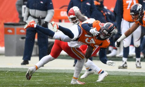 DENVER, CO - OCTOBER 25:  K.J. Hamler #13 of the Denver Broncos is tripped up before being tackled in the third quarter of a game against the Kansas City Chiefs at Empower Field at Mile High on October 25, 2020 in Denver, Colorado. (Photo by Dustin Bradford/Getty Images)
